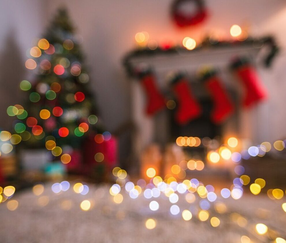 Defocused of christmas tree lights and fireplace